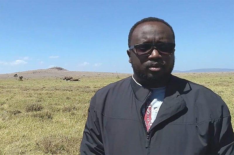 David Kimiti with rhinos