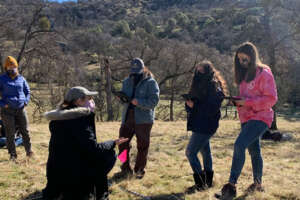 High school students learning how to monitor rangeland in the field